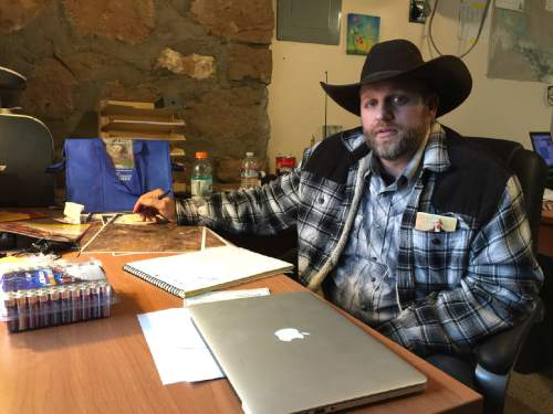 Ammon Bundy sits at a desk he was using at the Malheur National Wildlife Refuge in Oregon on Friday, Jan. 22, 2016. Bundy is the leader of an armed group occupying a national wildlife refuge to protest federal land policies.  (AP Photo/Keith Ridler)