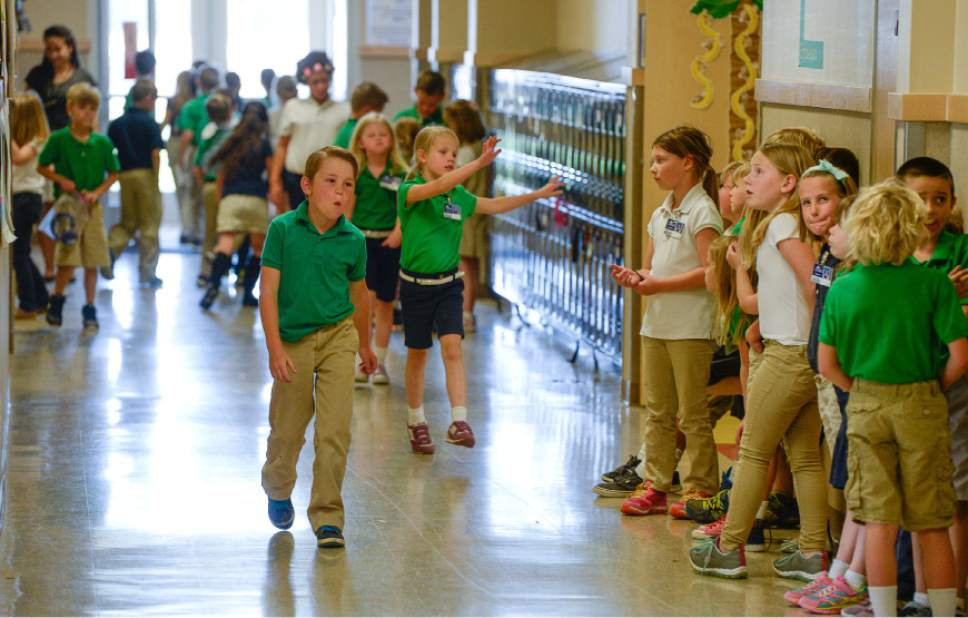 Francisco Kjolseth | The Salt Lake Tribune  Ascent Academy students fill the halls in preparation of a recess break.
