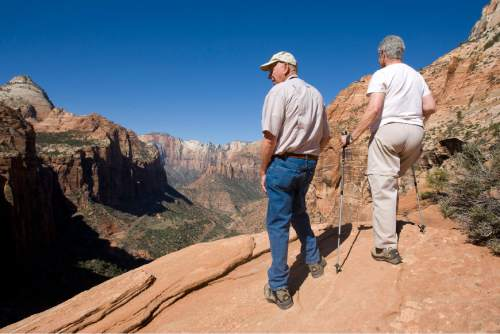 Al Hartmann  |  The Salt Lake Tribune Hikers look into the Zion Canyon from the Canyon Overlook Trail.
