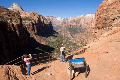 Al Hartmann  |  The Salt Lake Tribune Hikers pose for a picture looking into Zion Canyon from the Canyon Overlook Trail.