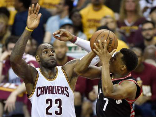 fcf7af2f4ebd Cleveland Cavaliers forward LeBron James defends as Toronto Raptors guard  Kyle Lowry looks to shoot during