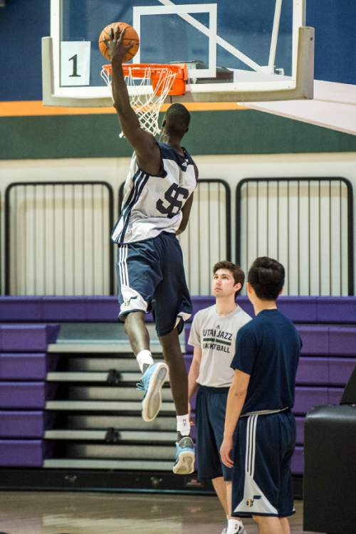Chris Detrick  |  The Salt Lake Tribune Thon Maker dunks the ball at the Zions Bank Basketball Center Wednesday May 25, 2016.