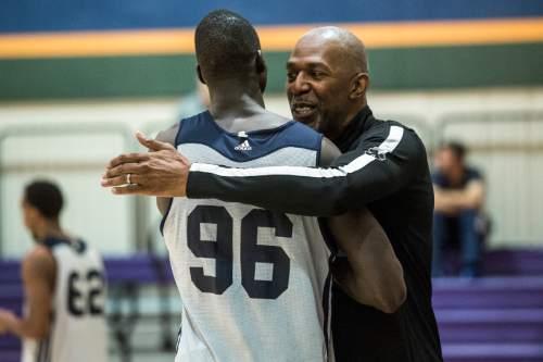 Chris Detrick  |  The Salt Lake Tribune Thurl Bailey hugs Thon Maker at the Zions Bank Basketball Center Wednesday May 25, 2016.