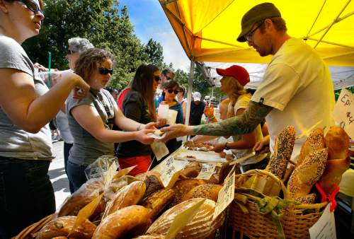 Scott Sommerdorf     The Salt Lake Tribune              The crowd at The Crumb Brothers Bakery stand at the opening Saturday of the Salt Lake Farmer's Market, Saturday, June 9, 2012. A new farmers market at Village Center Plazain Holladay will open starting June 4, 2016, and running through Oct. 29