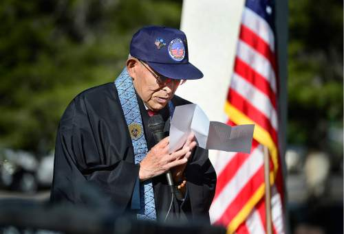 "Scott Sommerdorf   |  The Salt Lake Tribune   Salt Lake Buddhist Temple's Reverend Masami Hayashi, a veteran with MIS, reads the ""Sen No Kaze"" (A Thousand Winds) poem during the memorial service Sunday, May 29, 2016, honoring the achievements and sacrifices of Japanese American men killed in action fighting for the United States in World War II and other Japanese American veterans who have passed on. Most of those killed and honored by the monument were members of the 100th Infantry Battalion, the 442nd Regimental Combat Team and the Military Intelligence Service (MIS), U. S. Army units that received the U. S. Congressional Gold Medal of honor in 2010."