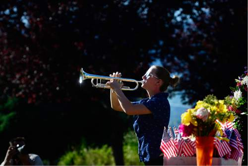 "Scott Sommerdorf   |  The Salt Lake Tribune   Sam Houston plays ""Taps"" during the memorial service Sunday, May 29, 2016, honoring the achievements and sacrifices of Japanese American men killed in action fighting for the United States in World War II and other Japanese American veterans who have passed on. Most of those killed and honored by the monument were members of the 100th Infantry Battalion, the 442nd Regimental Combat Team and the Military Intelligence Service (MIS), U. S. Army units that received the U. S. Congressional Gold Medal of honor in 2010."