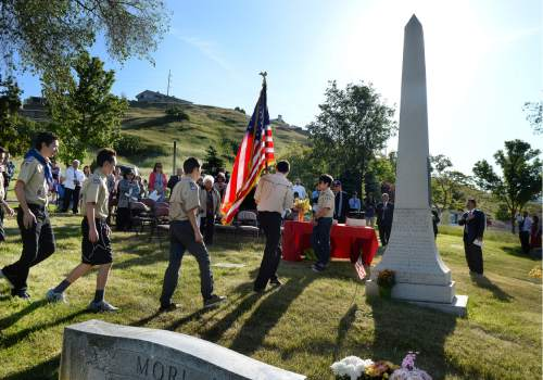 Scott Sommerdorf   |  The Salt Lake Tribune   Boy Scout Troop 1440 of the Dai Ichi Ward march in to post the colors during  a memorial service Sunday, May 29, 2016, honoring the achievements and sacrifices of Japanese American men killed in action fighting for the United States in World War II and other Japanese American veterans who have passed on. Most of those killed and honored by the monument were members of the 100th Infantry Battalion, the 442nd Regimental Combat Team and the Military Intelligence Service (MIS), U. S. Army units that received the U. S. Congressional Gold Medal of honor in 2010.