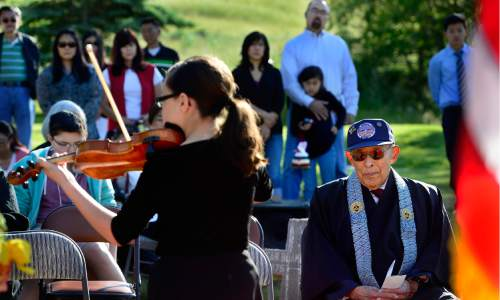 Scott Sommerdorf   |  The Salt Lake Tribune   Salt Lake Buddhist Temple's Reverend Masami Hayashi, a veteran with MIS, listens to Hannah Christensen perform a violin solo during a memorial service Sunday, May 29, 2016, honoring the achievements and sacrifices of Japanese American men killed in action fighting for the United States in World War II and other Japanese American veterans who have passed on. Most of those killed and honored by the monument were members of the 100th Infantry Battalion, the 442nd Regimental Combat Team and the Military Intelligence Service (MIS), U. S. Army units that received the U. S. Congressional Gold Medal of honor in 2010.