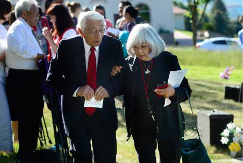 Scott Sommerdorf   |  The Salt Lake Tribune   Veteran Wat Misaka, left, walks with his sister Jeanette after the conclusion of a memorial service Sunday, May 29, 2016, honoring the achievements and sacrifices of Japanese American men killed in action fighting for the United States in World War II and other Japanese American veterans who have passed on. Most of those killed and honored by the monument were members of the 100th Infantry Battalion, the 442nd Regimental Combat Team and the Military Intelligence Service (MIS), U. S. Army units that received the U. S. Congressional Gold Medal of honor in 2010.