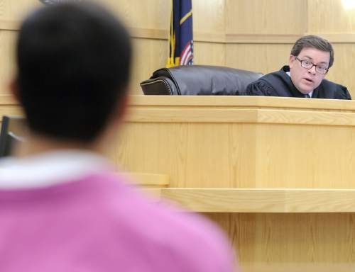 Judge Brian Cannell speaks to Jason Relopez in 1st District Court during a preliminary hearing on Thursday. Relopez was bound over to stand trial for rape and aggravated sexual assault.