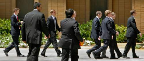 New missionaries walk on the campus of the Missionary Training Center in Provo June 25, 2007.   Steve Griffin/The Salt Lake Tribune