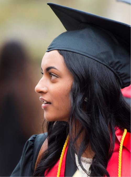 Rick Egan     The Salt Lake Tribune  Nisha Kavalam visits with class mates as she prepares for her graduation ceremony in the College of Social Work at Kingsbury Hall. Kavalam says administrators mishandled a sexual assault investigation after she reported being raped by a classmate. Thursday, May 5, 2016.