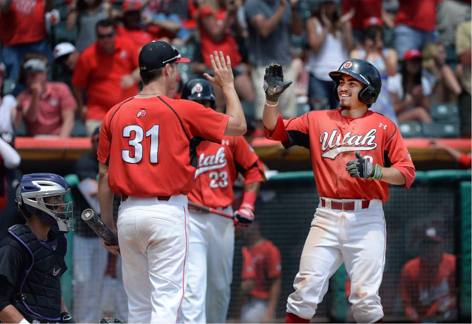 Scott Sommerdorf   |  The Salt Lake Tribune   Cody Scaggari is greeted at home plate after his home ruin made the score 11-2 in the 6th. Utah wins the Pac-12 baseball championship by defeating Washington, Sunday, May 29, 2016.