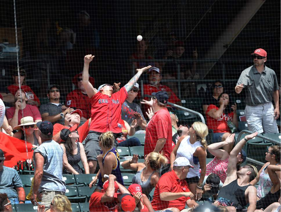 Scott Sommerdorf   |  The Salt Lake Tribune   Utah fans try for a foul ball during one of Utah's five-run innings. Utah wins the Pac-12 baseball championship by defeating Washington 21-7, Sunday, May 29, 2016.