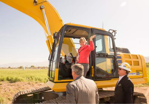 Rick Egan  |  The Salt Lake Tribune  Dr. Deneece G. Huftalin, President of Salt Lake Community College, waves after turning over a scoop of dirt during the ceremonial groundbreaking for the new Westpointe Career and Technical Education Center, Wednesday, June 1, 2016.
