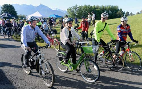 Al Hartmann  |  The Salt Lake Tribune  Salt Lake County Mayor Ben McAdams, left, and Salt Lake City Mayor Jackie Biskupski lead a group of bicyclists at the Sugarhouse Draw for the annual Mayorsí Bike to Work Day on Tuesday, May 31. The group rode Sugar House Draw (the bike/pedestrian tunnel under 1300 East and 2150 South), along the S-Line Greenway and the 600 East Bicycle Boulevard, and ended at the Salt Lake City and County Building at 400 South and State Street.
