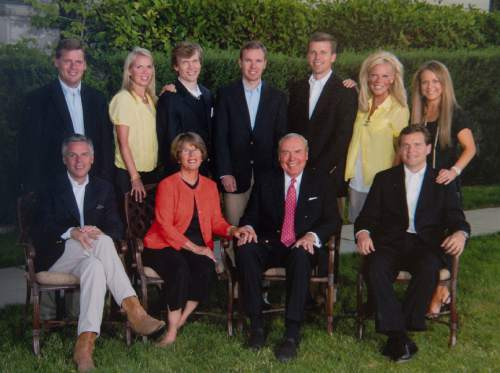 Photo courtesy of Paul Huntsman.   Jon Huntsman Sr., his wife Karen and their nine children at the Utah Governor's Mansion, 2009. (Front row, l-r) Former Utah governor Jon Huntsman Jr., Karen, Jon Sr. and Peter. (Back row) Mark, Jennifer, James, Paul, David, Kathleen and Christena.