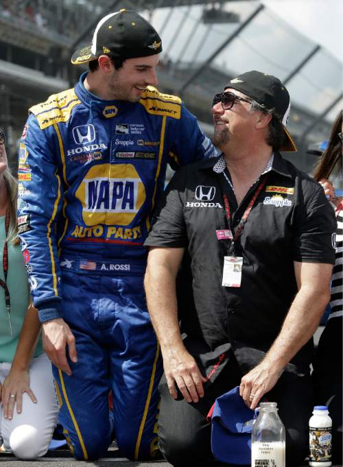 FILE - In this Sunday, May 29, 2016, file photo, Alexander Rossi, left,  celebrates with car owner Michael Andretti after winning the 100th running of the Indianapolis 500 auto race at Indianapolis Motor Speedway in Indianapolis. Michael Andretti is the greatest driver to never win the Indianapolis 500. He has done it four times as a car owner, though, most recently on Sunday with Rossi. It can be a bitter pill to swallow to watch a rookie win a race your family has chased for over 40 years, but Andretti harbored no jealousy over Rossi's improbable victory.  (AP Photo/R Brent Smith)