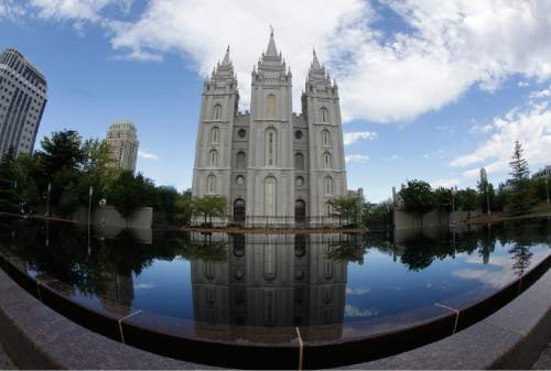 This Friday, July 10, 2015, photo shows the Salt Lake Temple at Temple Square in Salt Lake City. (AP Photo/Rick Bowmer)