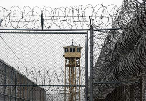 Rick Bowmer  |  AP File Photo A watch tower is seen at the Wasatch facility during a 2015 media tour at the Utah State Correctional Facility in Draper. Moving the Utah State Prison will take longer than projected because of a new study looking into whether the drying Great Salt Lake exposes toxic metals that could pose health hazards.