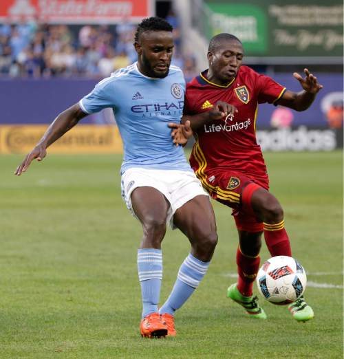 New York City FC forward Stiven Mendoza, left, vies for control of the ball against Real Salt Lake midfielder Demar Phillips during the first half of an MLS soccer game, Thursday, June 2, 2016, in New York. Real Salt Lake won 3-2. (AP Photo/Julie Jacobson)
