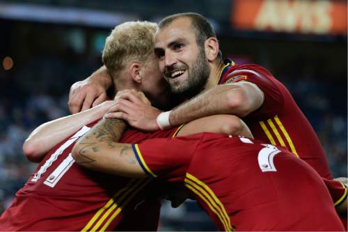 Real Salt Lake forward Yura Movsisyan, right, celebrates with teammates after New York City FC scored an own goal during the second half of an MLS soccer game, Thursday, June 2, 2016, in New York. Real Salt Lake won 3-2. (AP Photo/Julie Jacobson)