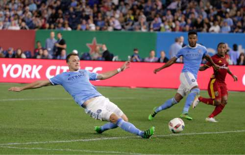 New York City FC defender Frederic Brillant, left, scores an own goal during the second half of an MLS soccer game against Real Salt Lake, Thursday, June 2, 2016, in New York. Real Salt Lake won 3-2. (AP Photo/Julie Jacobson)