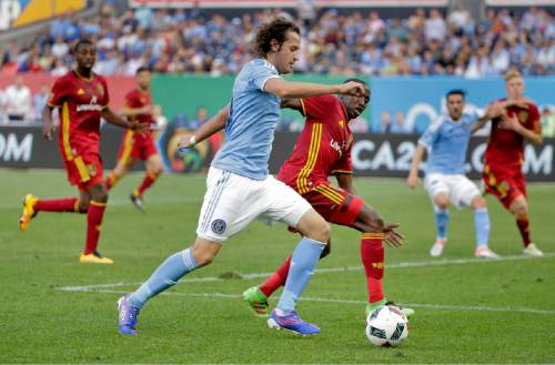 New York City FC midfielder Mikkel Diskerud, left, looks to score while being defended by Real Salt Lake midfielder Demar Phillips, right, during the first half of an MLS soccer game, Thursday, June 2, 2016, in New York. Real Salt Lake won 3-2. (AP Photo/Julie Jacobson)