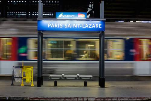 An operating train departs from the Gare Saint Lazare train station in Paris, Thursday, June 2, 2016. Workers at the SNCF national rail authority, whose train service will be crucial to Euro 2016 spectators, are on an open-ended strike to protest their working conditions and a controversial government labor reform. (AP Photo/Markus Schreiber)