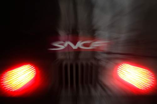 In this photo taken with a long shutter and using the zoom during exposure, a train of the SNFC stands on the track inside during a strike at the Gare du Nord train station, in Paris, Thursday, June 2, 2016. Workers at the SNCF national rail authority, whose train service will be crucial to football's Euro 2016 spectators, are on an open-ended strike to protest their working conditions and a controversial government labor reform. (AP Photo/Markus Schreiber)