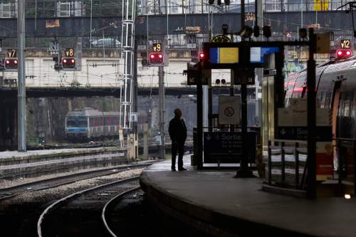 A man stands on a platform at the Gare Saint Lazare train station, in Paris, Thursday, June 2, 2016. Workers at the SNCF national rail authority, whose train service will be crucial to football's Euro 2016 spectators, are on an open-ended strike to protest their working conditions and a controversial government labor reform. (AP Photo/Markus Schreiber)