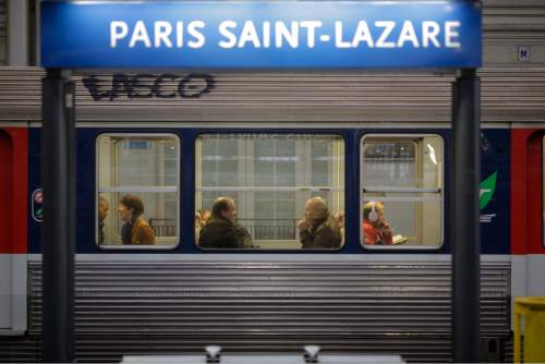 Commuters wait in a train at the Gare Saint Lazare train station in Paris, Thursday, June 2, 2016. Workers at the SNCF national rail authority, whose train service will be crucial to Euro 2016 spectators, are on an open-ended strike to protest their working conditions and a controversial government labor reform. According to the SNCF national rail authority, about 40 percent of France's high-speed trains and more than half of regional trains are cancelled. (AP Photo/Markus Schreiber)