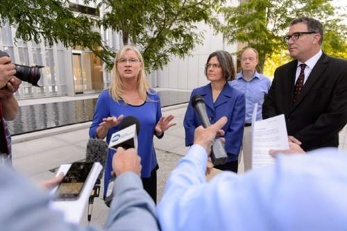 Trent Nelson   |   The Salt Lake Tribune Joan O'Brien of Utah Newspaper Project/Citizens for Two Voices, left, announces that the group is dropping its antitrust lawsuit as the sale of The Salt Lake Tribune to Paul Huntsman closed, Tuesday May 31, 2016. The group held a press conference at the Federal Courthouse in Salt Lake City, with Joan O'Brien, Karra Porter, Ted McDonough, Patty Henetz (not pictured), and Dave Richards.