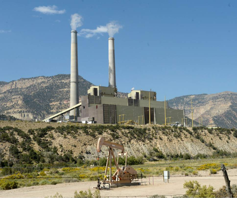 Al Hartmann  |  The Salt Lake Tribune PacifiCorp's Huntington coal-fired power plant could be producing more power -- and emitting slightly more carbon -- if the utility is an early joiner of a proposed regional electric grid. But by 2030, according to a study of the grid's benefit, overall carbon emissions across the western U.S. would drop by as much as 3.5 percent as more states take advantage of renewable energy.