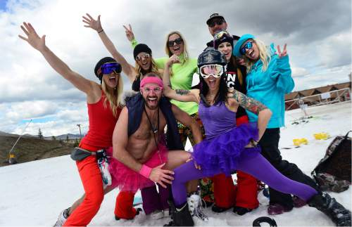 Scott Sommerdorf   |  The Salt Lake Tribune   A group of friends including Brandon Levi, front left, and Lindsey Armstrong, front right, celebrate their day on the last day of skiing at Park City Sunday, April 10, 2016.
