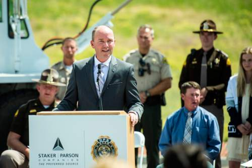 Chris Detrick  |  The Salt Lake Tribune Lt. Governor Spencer Cox speaks during a 'Stop to Talk, Stop to Text' safety initiative press conference in at Staker Parson Paving in Draper on Thursday.