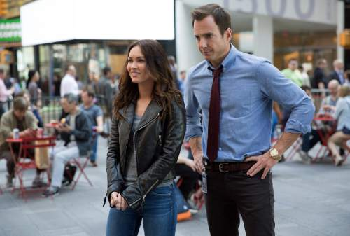 "This image released by Paramount Pictures shows Megan Fox as April O'Neil, left, and Will Arnett as Vernon Fenwick in a scene from ""Teenage Mutant Ninja Turtles: Out of the Shadows."" (Jessica Miglio/Paramount Pictures via AP)"