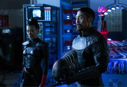 "This image released by Paramount Pictures shows Brittany Ishibashi as Karai, left, and Brian Tee as Shredder in a scene from ""Teenage Mutant Ninja Turtles: Out of the Shadows."" (Jessica Miglio/Paramount Pictures via AP)"