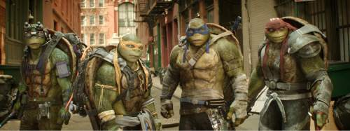 "This image released by Paramount Pictures shows, from left, Donatello, Michelangelo, Leonardo and Raphael in a scene from ""Teenage Mutant Ninja Turtles: Out of the Shadows."" (Lula Carvalho/Paramount Pictures via AP)"