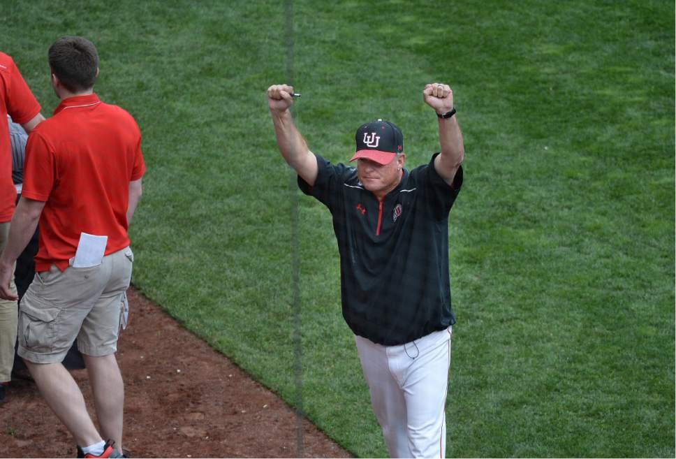 Scott Sommerdorf   |  The Salt Lake Tribune   Utah head coach Bill Kinneberg raises his hands in victory as Utah celebrates winning it's first Pac-12 baseball championship by defeating Washington 21-7, Sunday, May 29, 2016.