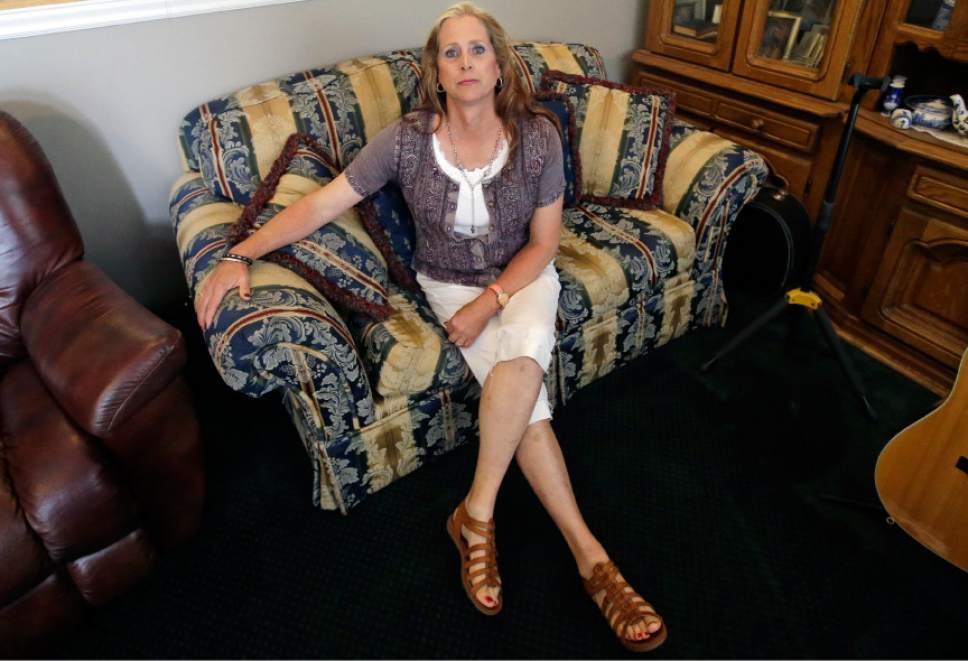 Angie Rice sits at home, Tuesday, May 17, 2016, in Mountain Green, Utah. In the year since Utah passed a Mormon church-backed anti-discrimination law protecting gay and transgender people, 22 complaints were filed alleging discrimination in the workplace or in housing. Utah public school teacher Angie Rice, a transgender woman who says the law's protections gave her the courage to come out to administrators and students. (AP Photo/Rick Bowmer)