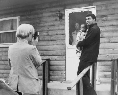 The champ was here ali sparred at the salt palace met third wife pop artist andy warhol left is shown photographing muhammad ali his infant daughter thecheapjerseys Image collections