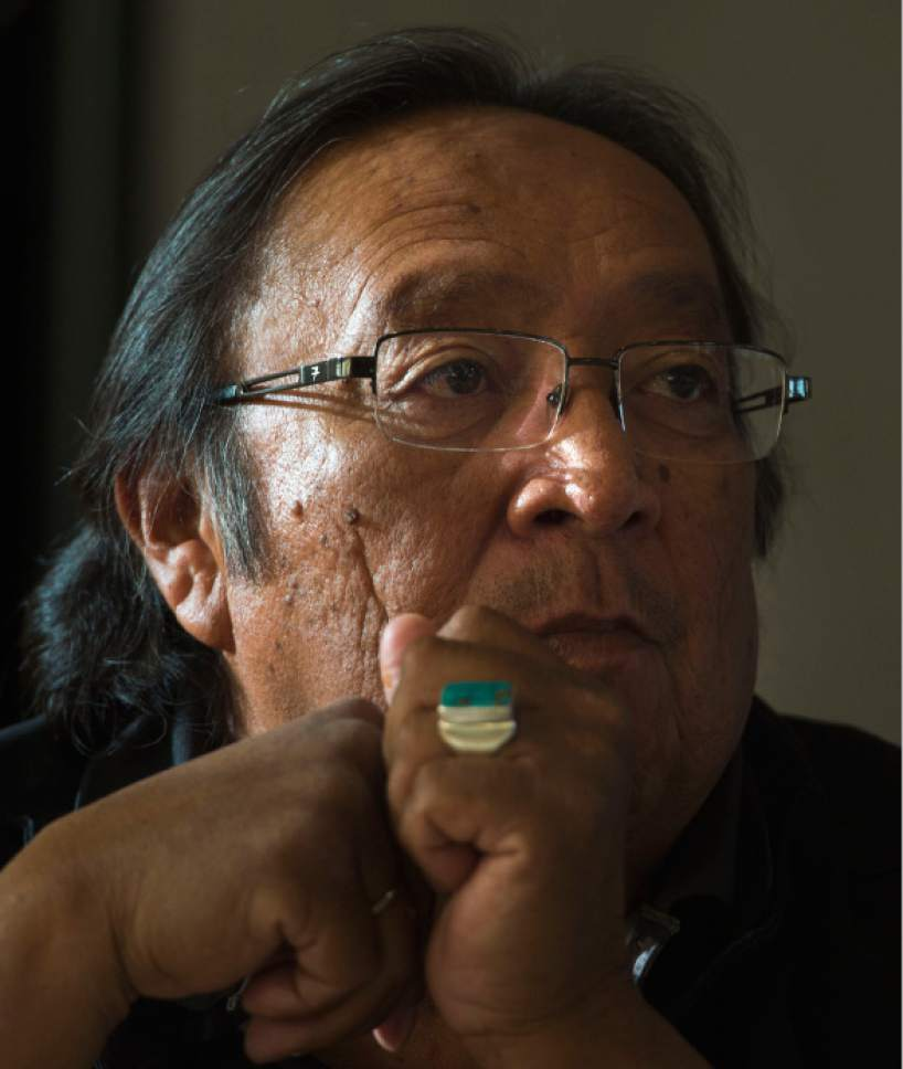 Steve Griffin / The Salt Lake Tribune  Utah Dine Bikeyah board member Jonah Yellowman  listens as Utah Dine Bikeyah chairman Willie Grayeyes answers questions during a stop at the Urban Indian Center in Salt Lake City Wednesday June 1, 2016.  Five board members are touring the state meeting with Native Americans to drum up support for the Bears Ears national monument and answer questions in the face of allegations their groups is a front for outside environmental groups.