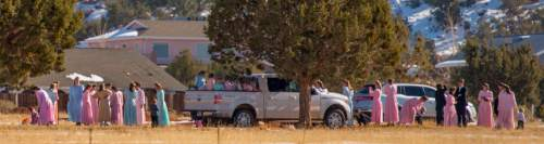 Trent Nelson     The Salt Lake Tribune A large group of FLDS members pays a visit to the city cemetery in Colorado City Sunday December 15, 2013.