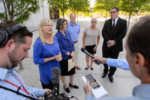 Trent Nelson  |  The Salt Lake Tribune Joan O'Brien of Utah Newspaper Project/Citizens for Two Voices, left, announces that the group is dismissing its antitrust lawsuit as the sale of The Salt Lake Tribune to Paul Huntsman closed, Tuesday May 31, 2016. The group held a press conference at the Federal Courthouse in Salt Lake City, with Joan O'Brien, Karra Porter, Ted McDonough, Patty Henetz, and Dave Richards.