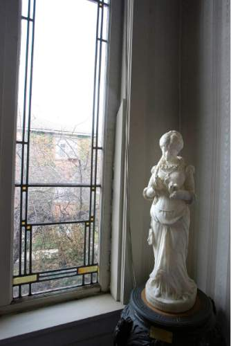 |  Tribune File Photo  A  statue stands near  one of the original  windows at the Ladies' Literary Club, Tuesday, April 2, 2013.