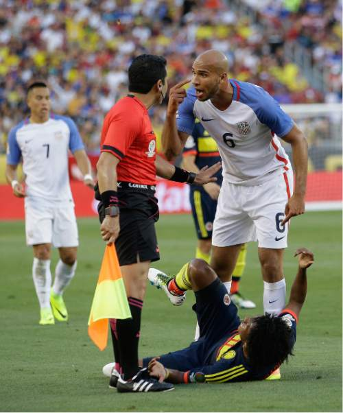 John Brooks of the United States, argues with the linesman after he fouled Colombia's Juan Cuadrado during a Copa America Centenario Group A soccer match at Levi's Stadium in Santa Clara, Calif., Friday, June 3, 2016. (AP Photo/Marcio Jose Sanchez)