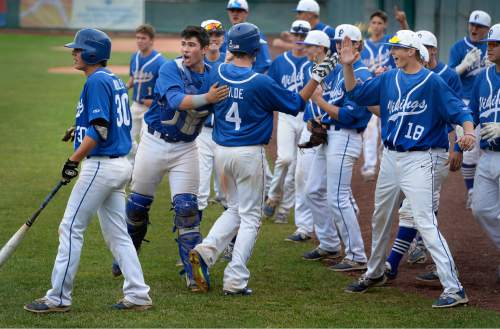 Scott Sommerdorf      The Salt Lake Tribune Payton Henry, and the rest of the Vikings greet Matthew Wilde after he scored during the Vikings' 4-run rally in the 5th inning. Pleasant Grove defeated Bingham 6-2 to win the Utah 5A title, Thursday, May 21, 2015.