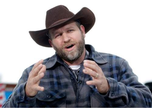 FILE - In this Jan. 5, 2016, file photo, Ammon Bundy speaks during an interview at Malheur National Wildlife Refuge, near Burns, Ore. Amid debate about whether they should be tried first in federal court in Oregon or Nevada, Ammon Bundy and his brother Ryan, sons of Nevada rancher Cliven Bundy and three other men are due in court, Friday, April 15, 2016, before a judge in Las Vegas, on charges stemming from an armed confrontation with government agents rounding up cattle two years ago. (AP Photo/Rick Bowmer, File)