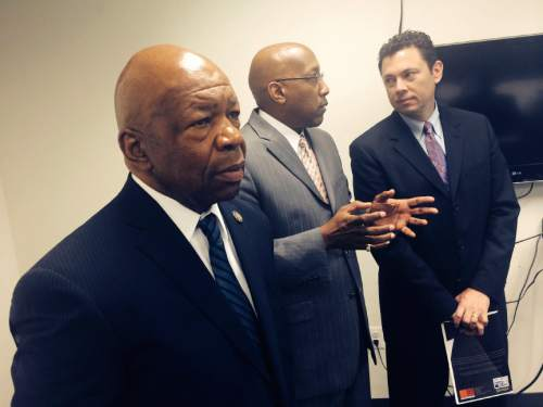 Thomas Burr  |  Tribune file photo Rep. Elijiah Cummings, D-Md., (left) hosted Rep. Jason Chaffetz, R-Utah, (right) in a tour of the Democrat's district, including this visit to the Center for Urban Families. The center director, Joseph Jones, (center) explains the organization.